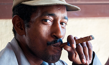 Cuban man smoking cigar.